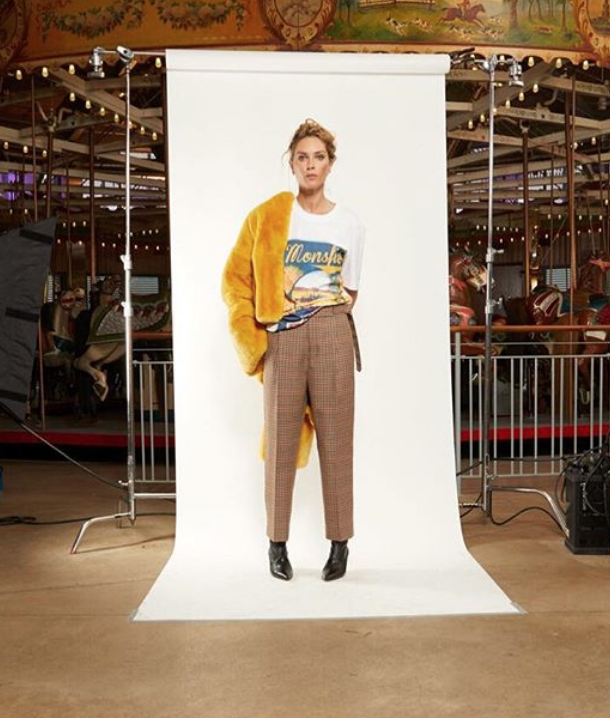 monse maison wearing a yellow jacket and brown chequered trousers