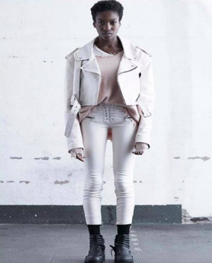 black model wearing white leather jacket by Ben Taverniti Unravel Project