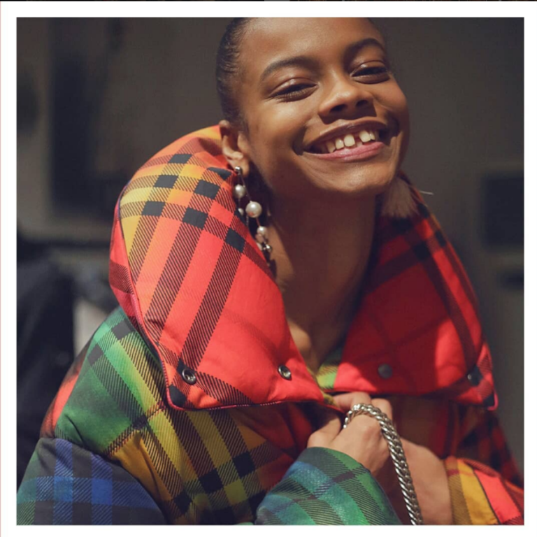 aaliyah hydes wearing a multi coloured burberry puffer coat