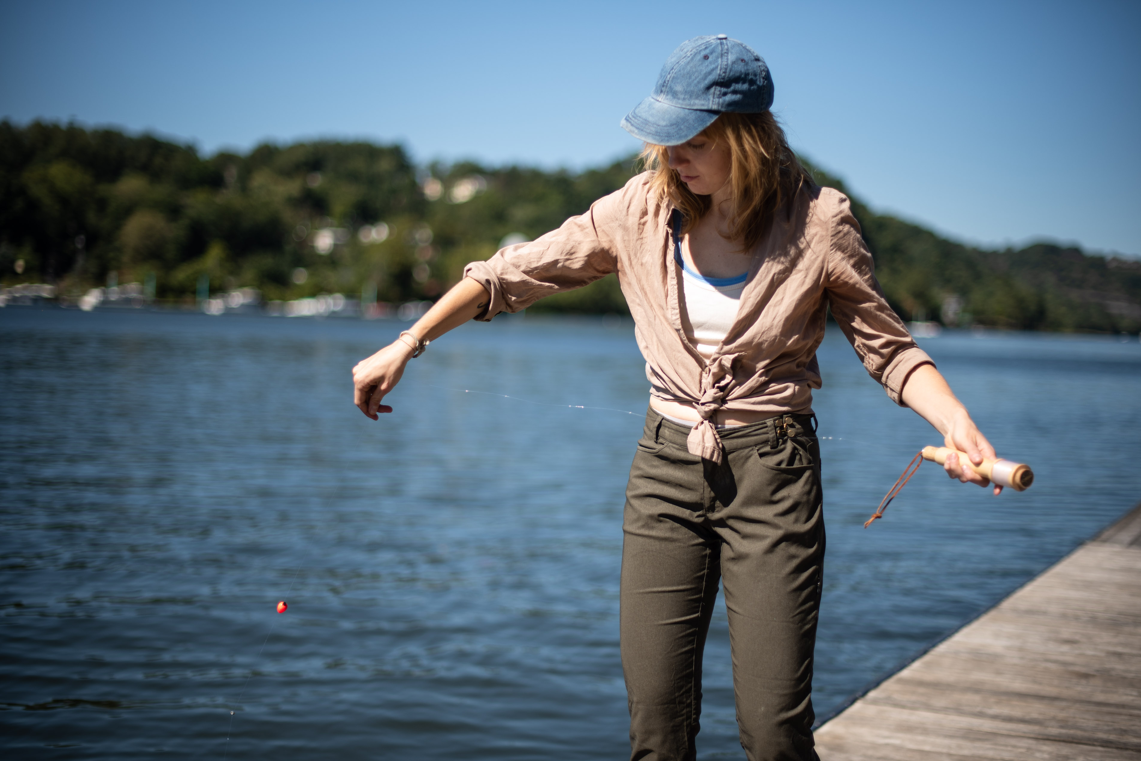 Toss-casting a portable fishing rod