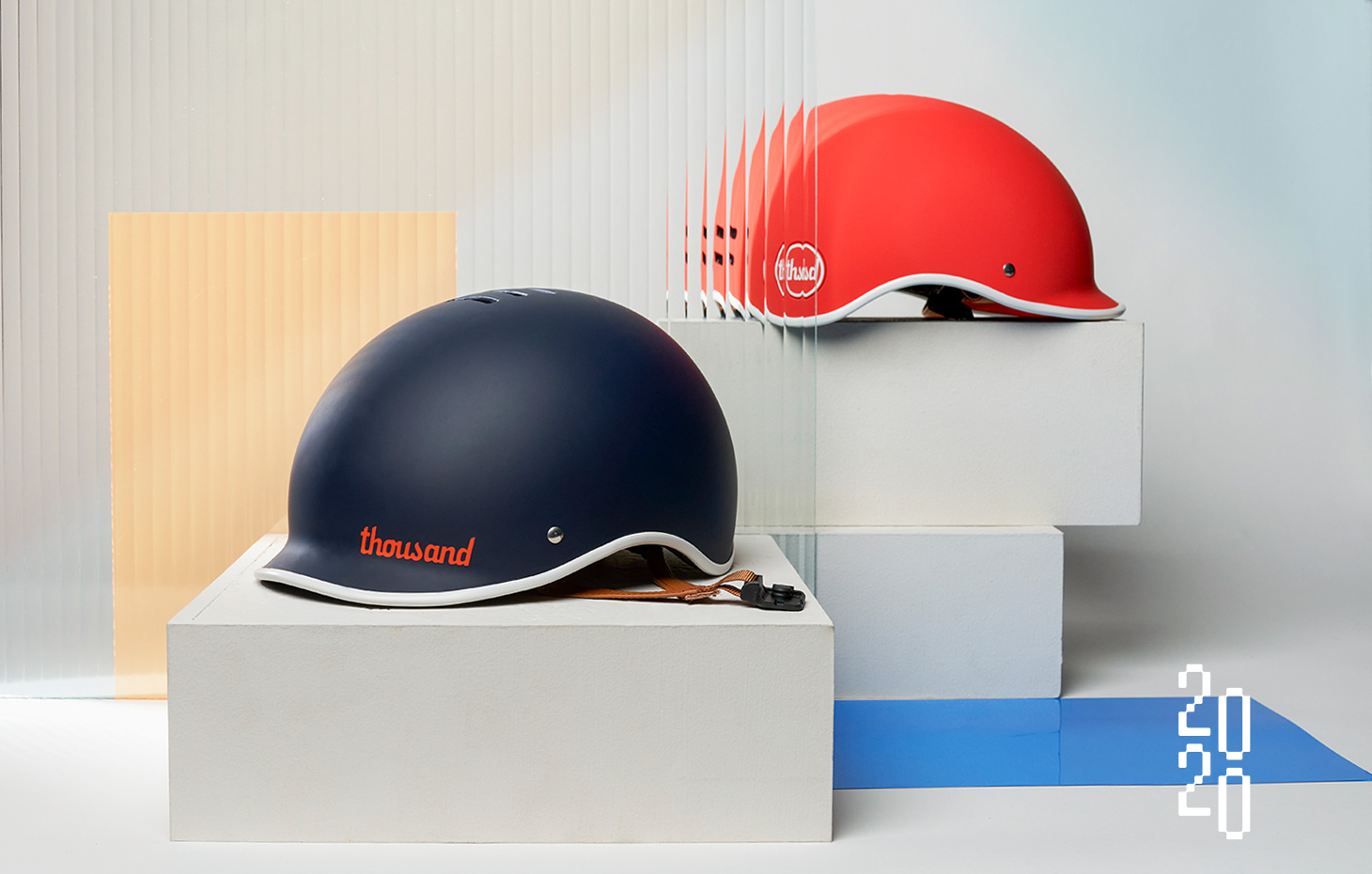 blue bike helmet and red bike helmet