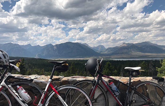Bike shot with black bike helmet with mountains in background