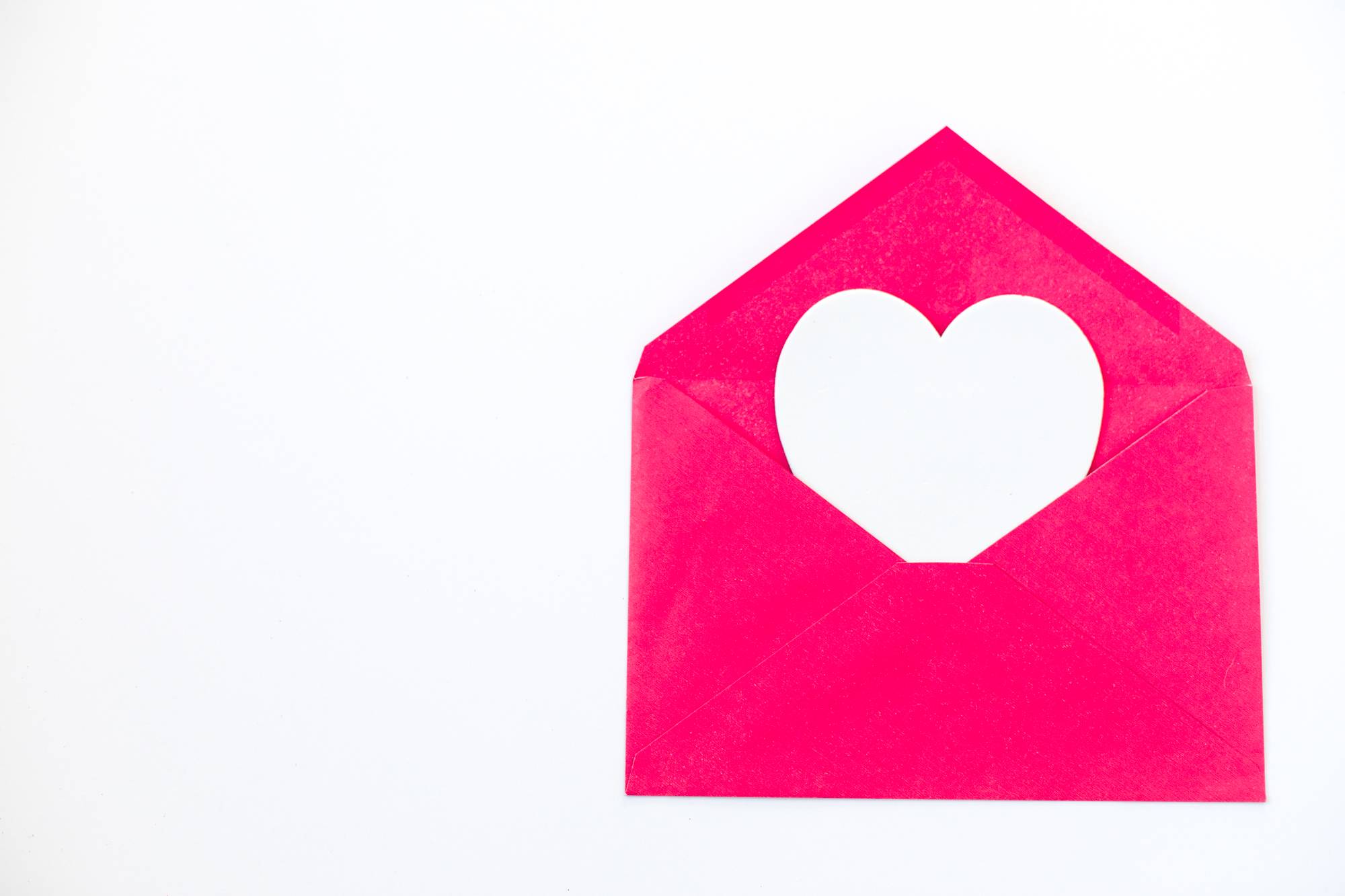 white heart, pink envelope, white heart poking out of envelope, tografy, photography business management