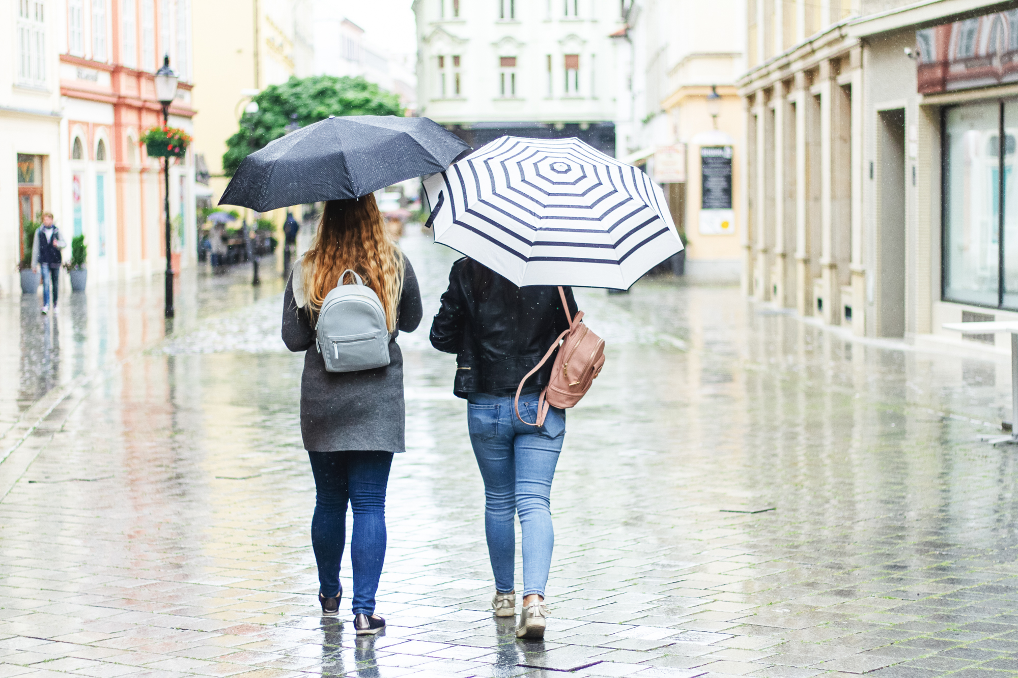Two Girls Walking with Umbrellas In the Rain, Tografy, What to do when it rains on the day of your photo session