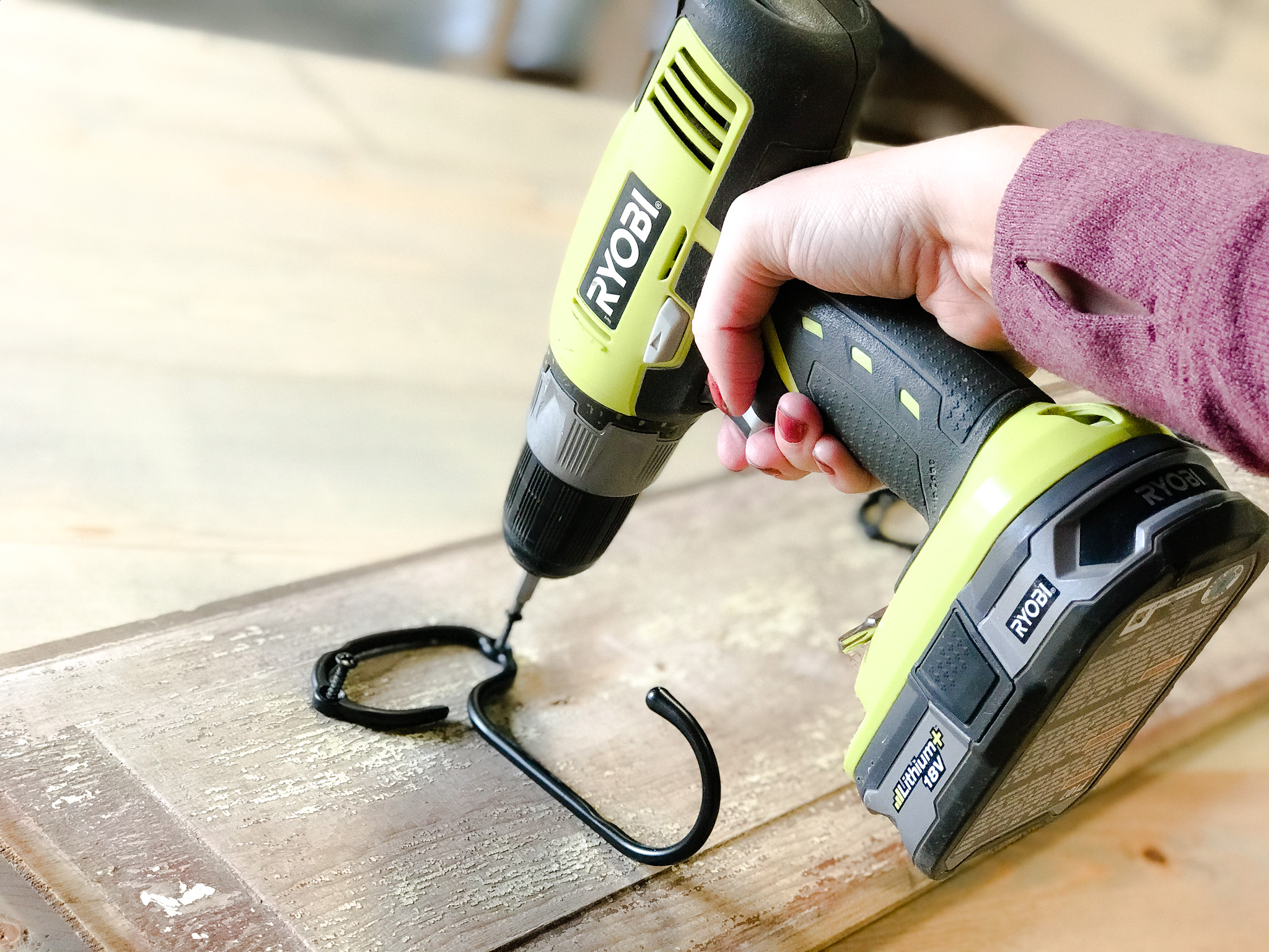 using a drill to attach a hook