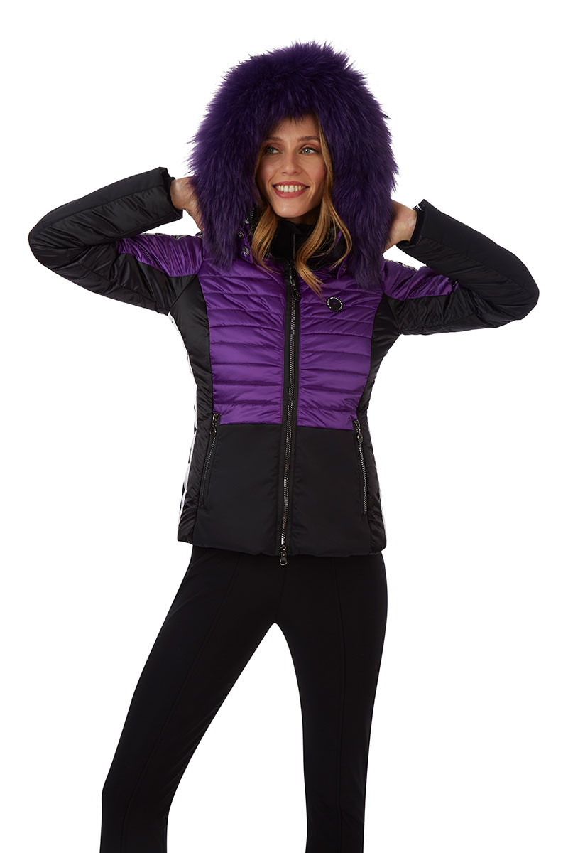 Luxury ski jacket in purple with fur trim at Winternational