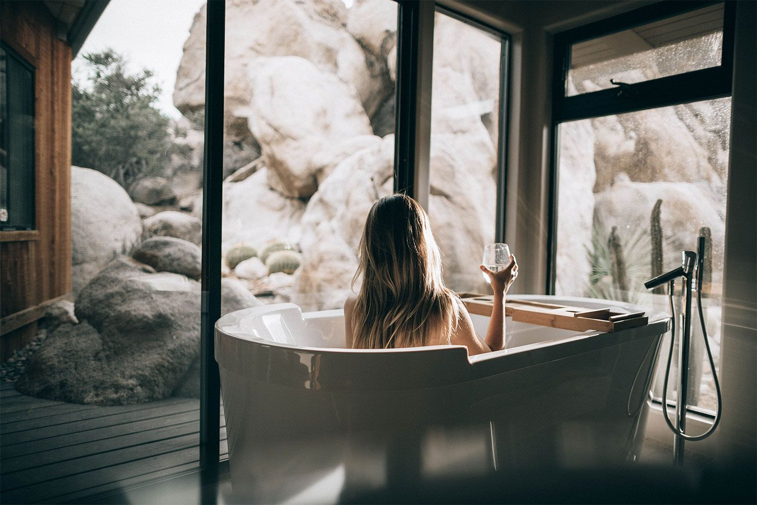 Lady taking a bath in a chalet